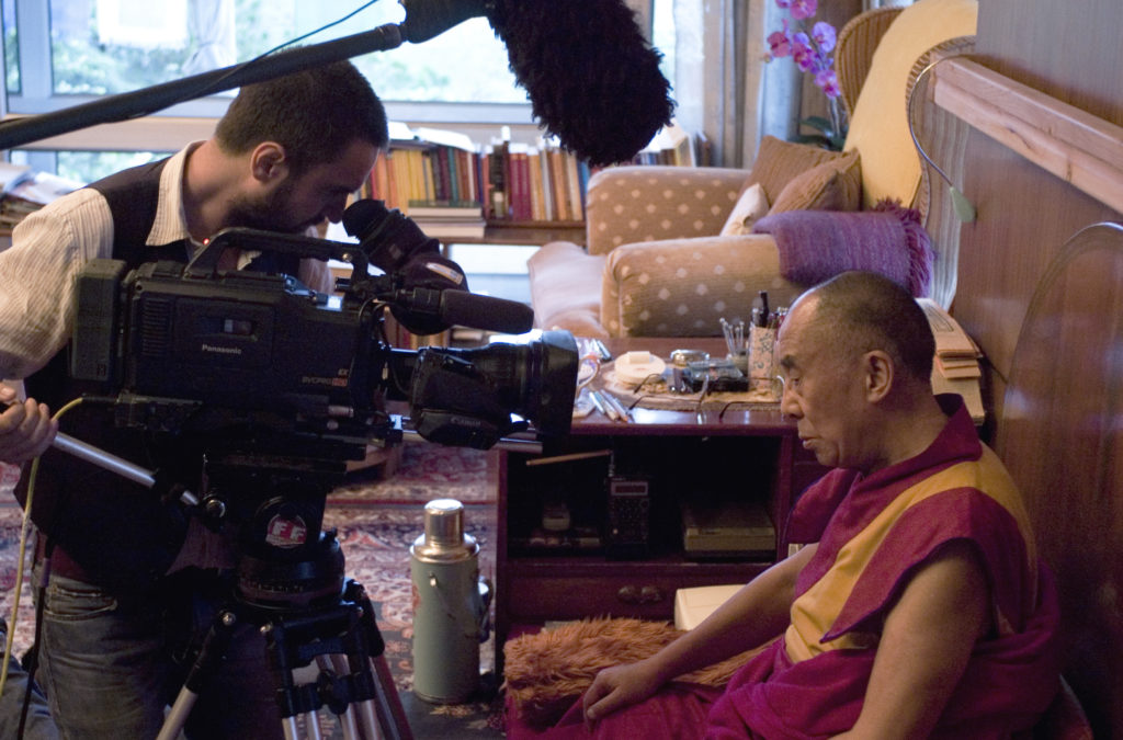 DoP Jaimie Gramston filming His Holiness the Dalai Lama during The Sun Behind the Clouds shoot